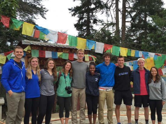 ACE in China students standing in front of prayer flags