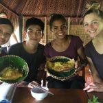 ACE Athletes trying a savory Vietnamese pancake
