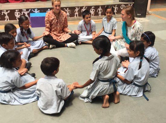 ACE Student-Athletes Sitting with VIDYA Children
