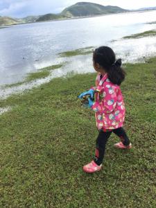 Kira Picking Up Trash at Wetlands