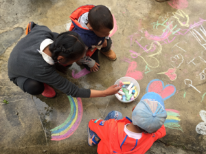 Kids Playing with Sidewalk Chalk