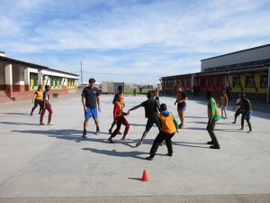 ACE Student-Athletes Play Soccer with Children