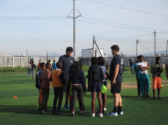 ACE in South Africa Group Prepare to Play Rugby on Field with Kids