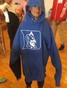 Child Wearing Duke Sweatshirt