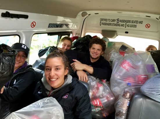 ACE Student-Athletes Transporting Trash