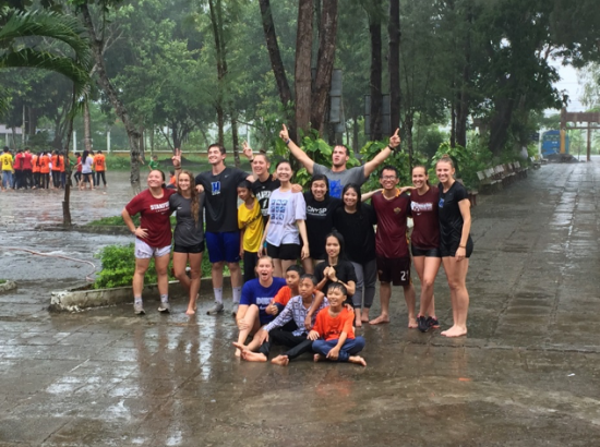 ACE Student-Athletes Playing in Rain with Children