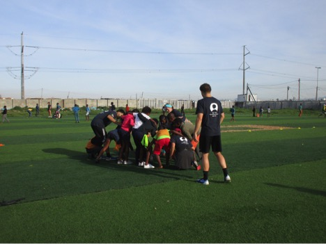 ACE Student-Athletes and Kids Playing on the Rugby Pitch