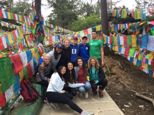 ACE in China Group at the Monastery Surrounded by Prayer Flags