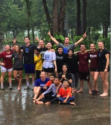 Coaches and Kids from Camp Playing in the Rain