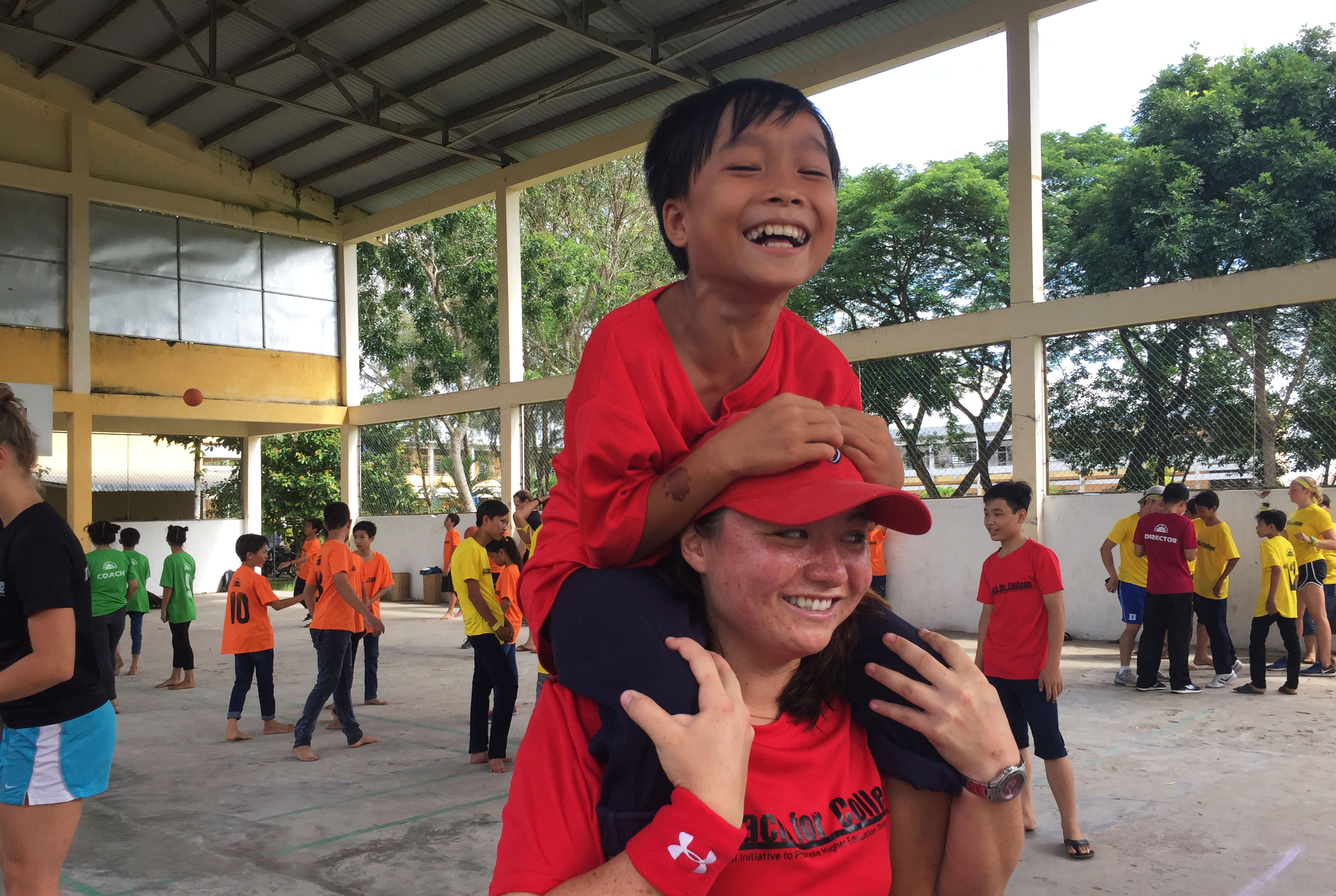ACE Student-Athlete Giving Camper Piggyback Ride