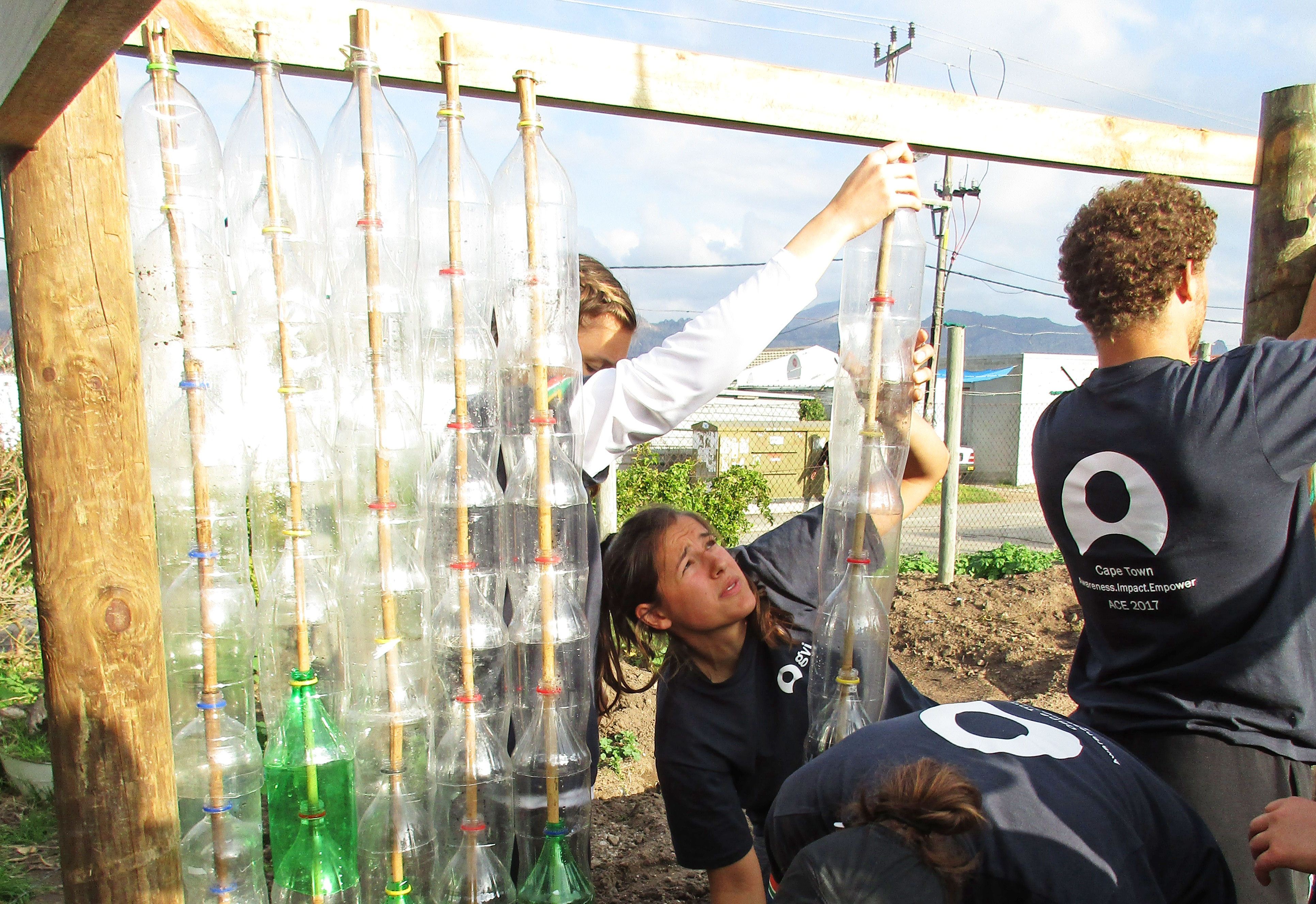 ACE Student-Athletes Building Greenhouse