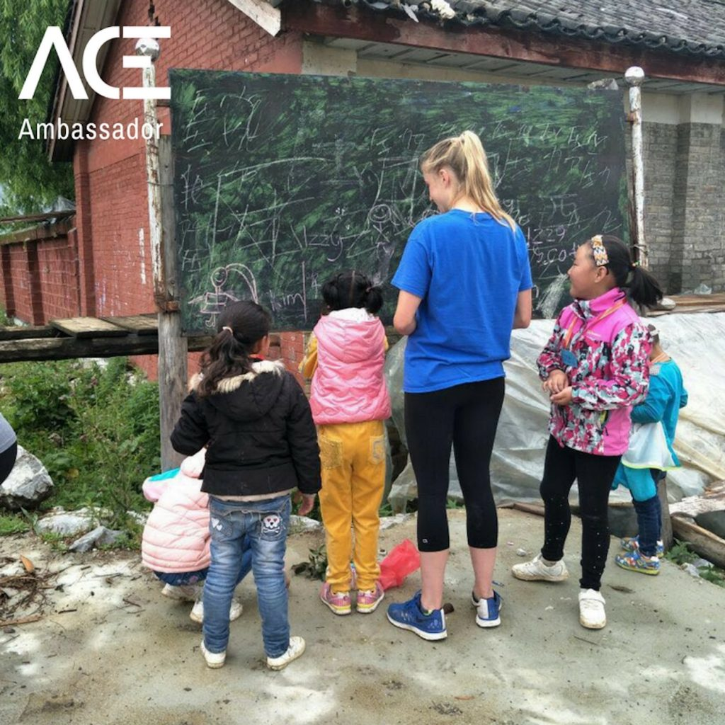 ACE participant chalking with children outside