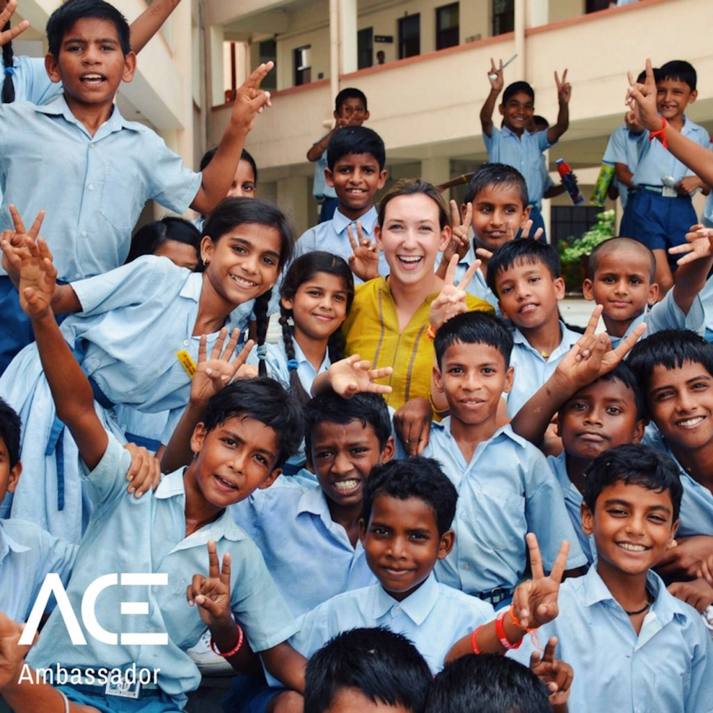 ACE participant with school children