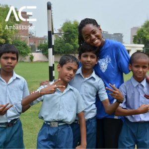ACE participant posing with children