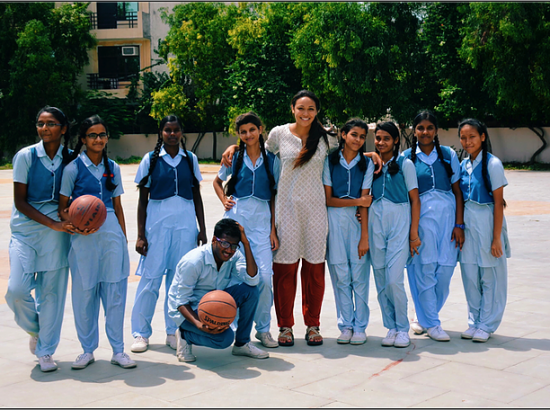 ACE Student-Athlete Playing Basketball with VIDYA Students