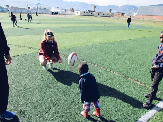 Logan Playing Rugby with Children Outside
