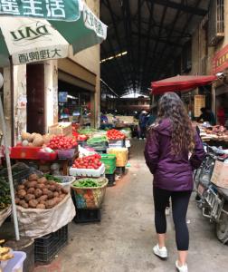 Shannon Walking through the Wet Market