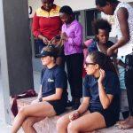 Students Braiding ACE Student-Athletes' Hair