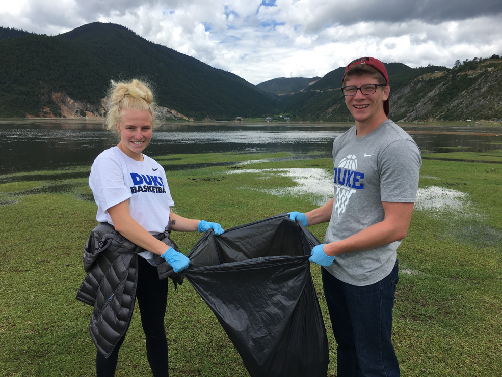 Student-Athletes Cleaning Up Trash at Wetlands