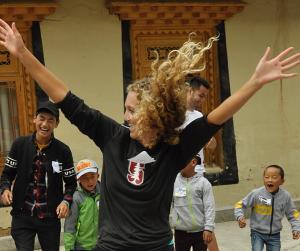 Kat Dancing with Children