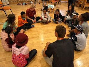 ACE participant teaches group camp lesson