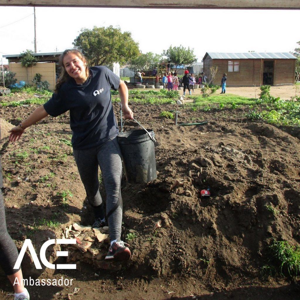 ACE participant building greenhouse