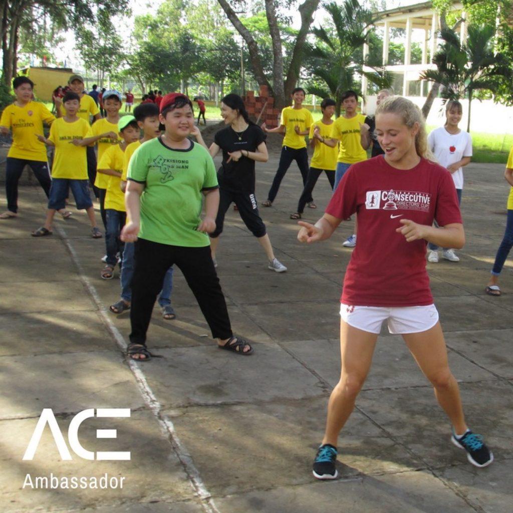 ACE participant dancing outside