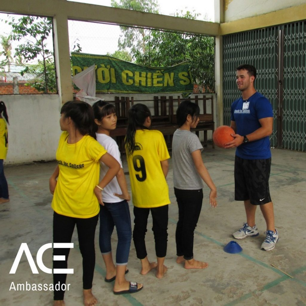 ACE participant teaching basketball