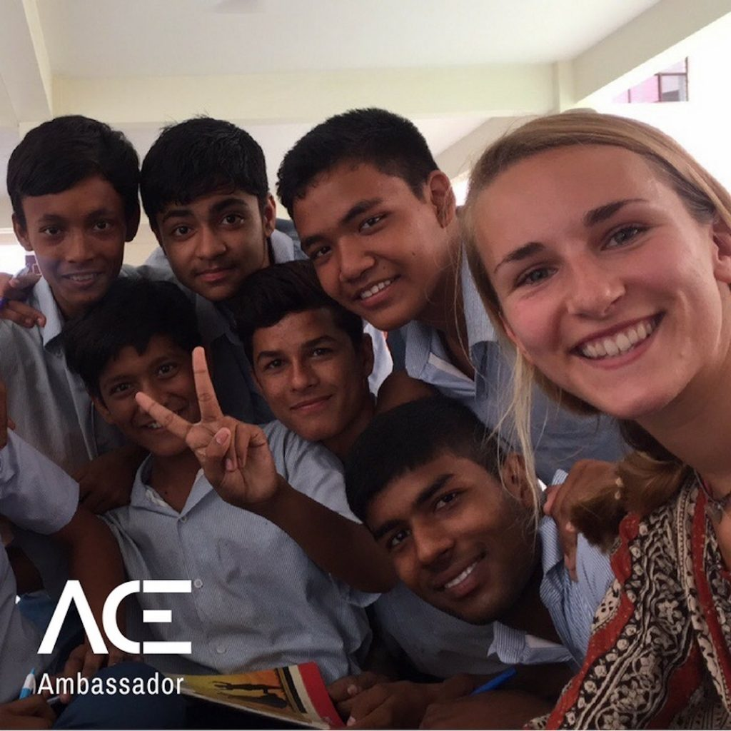ACE participant selfie with VIDYA school kids