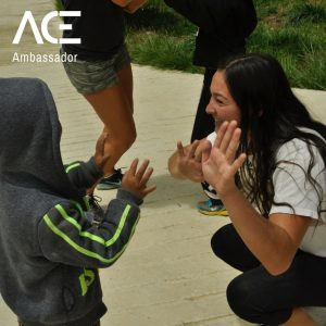 ACE participant high fives kids
