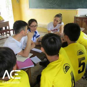 ACE participants doing homework with kids