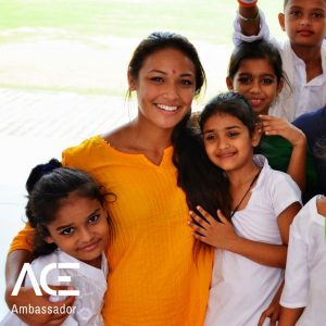 ACE participant posing with VIDYA school children