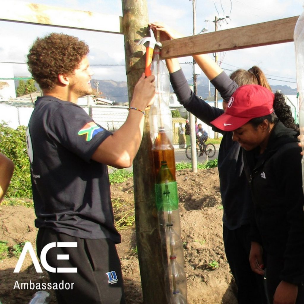 ACE participants building greenhouse