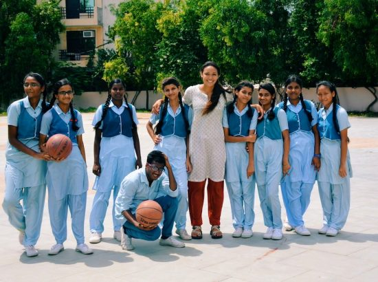 ACE participant with VIDYA students playing basketball