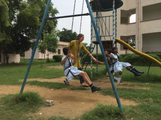 ACE participants and children swinging
