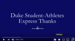 "screen that reads ""Duke student-athletes express thanks"""