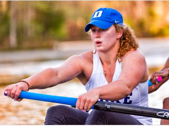 woman rowing outside