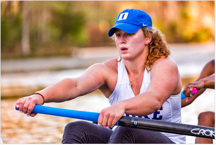 female rowing outside