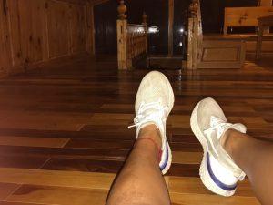 white sneakers, red anklet, taken inside