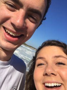 Close-up selfie of amelia and max with ocean background