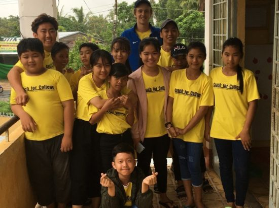 Duke student with Vietnamese students in yellow t-shirts