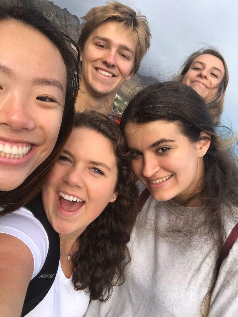 Group of 5 people posing for selfie