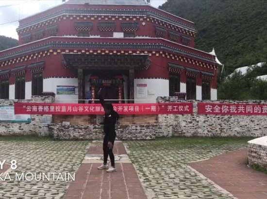 videoscreenshot of youtube video with a student standing in front of a temple
