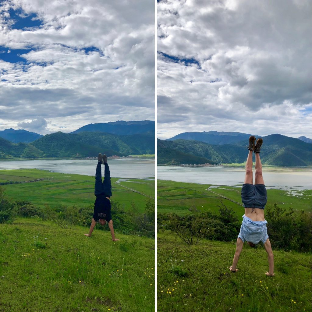 two students doing handstands