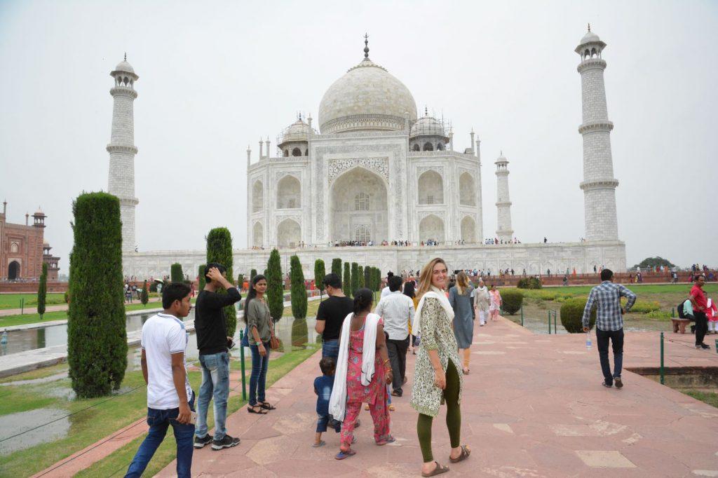 student in front of Taj Mahal