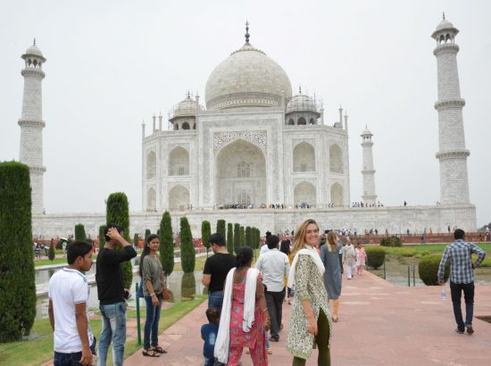 student in front of Taj Mahal