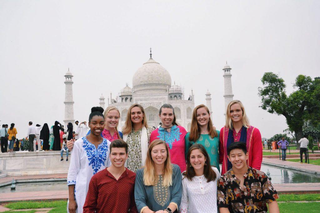 ten student standing in front of the Taj Mahal