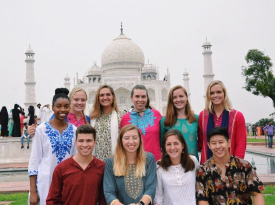 ten student standing in front of the Taj Mahal