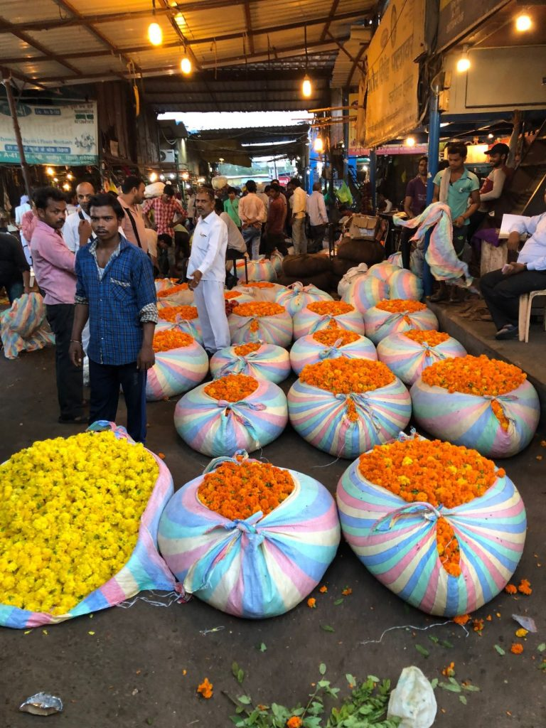 bags of orange and yellow flowers
