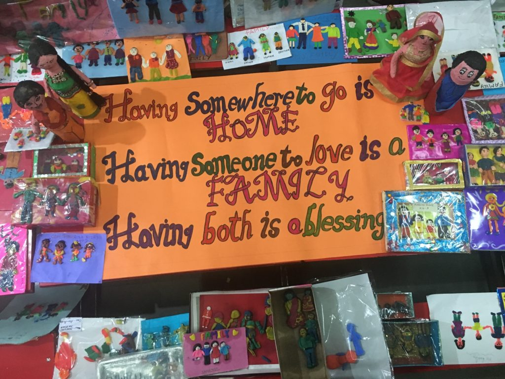 "sing on door that says ""having somewhere to go is home, having someone to love is family, having both is a blessing"""